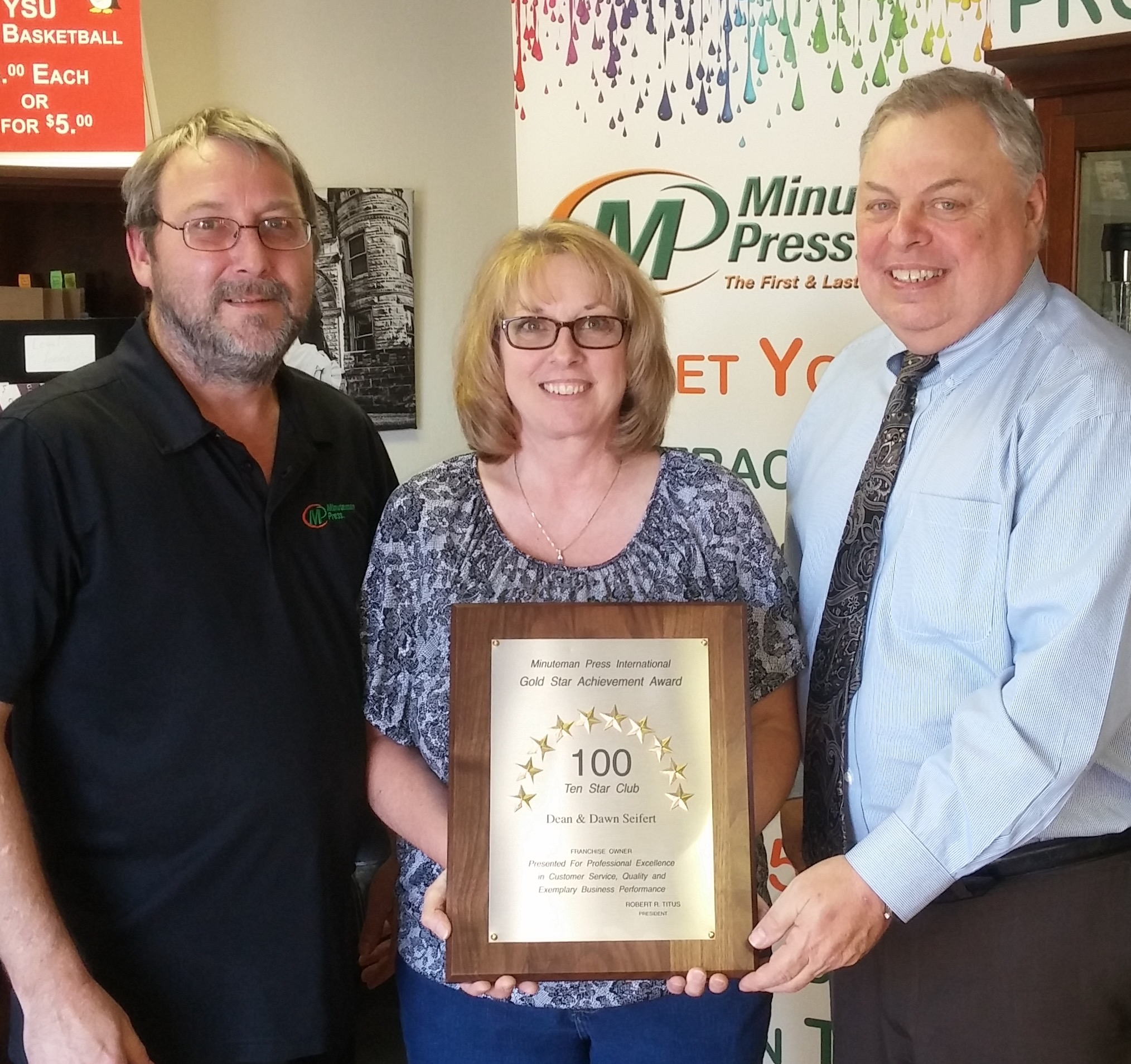Youngstown, Ohio Minuteman Press franchise owners Dean Seifert (left) and Dawn Seifert (center), along with Gary Nowak (right), Minuteman Press International Regional Vice President for the Ohio region